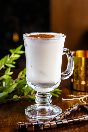 glass cup: Tea with milk and cinnamon in a glass Cup Stock Photo