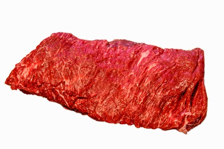 Bavette steak,or Flank steak iron is on a white background. Insulated