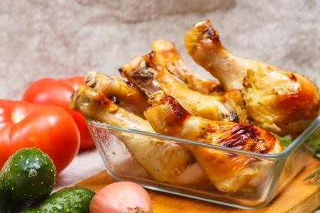 drumsticks: Baked chicken drumsticks, barbecue. Stock Photo
