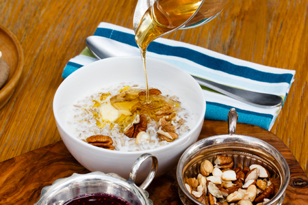 oatmeal: Honey poured into your oatmeal, good Breakfast. Stock Photo