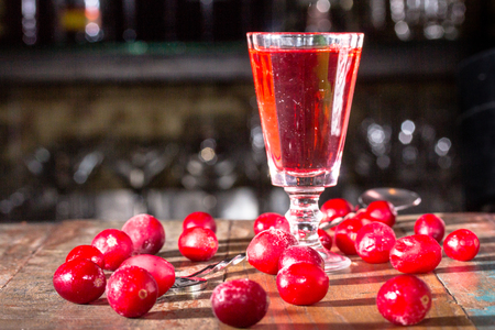 alcoholic drink: Liqueur infused with cranberries - Klukovka. Traditional Russian strong alcoholic drink. Stock Photo