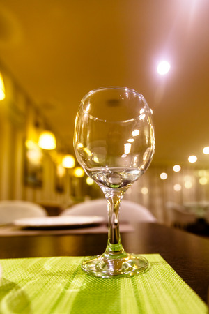 Empty glasses stand on the table in the restaurant. Stock Photo