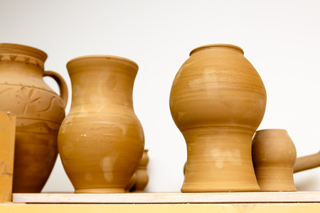 A pottery. Pots and jars without a pattern are on the shelves.