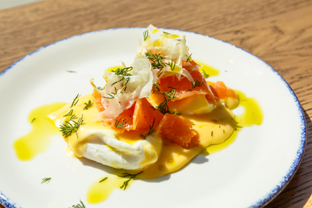A poached egg with salted salmon Benedict . Sunny morning, Breakfast Stock Photo
