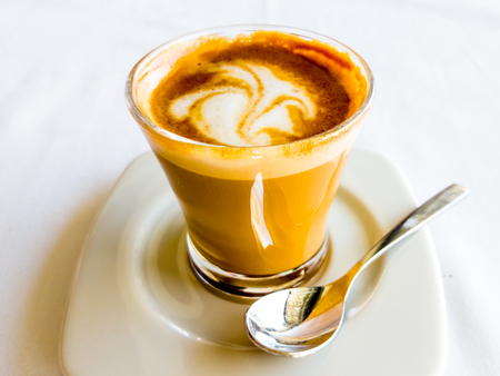 Traditional coffee in Spain - cortado in a glass Cup. Stock Photo