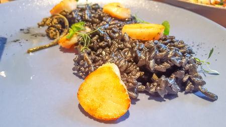 Black risotto with cuttlefish ink and scallops.