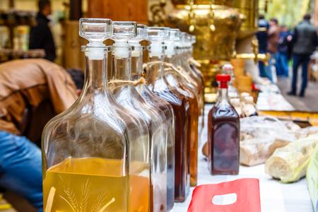 Transparent bottles of different alcoholic beverages - cordials and liqueurs.
