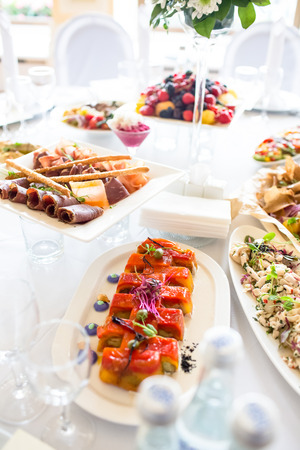 Salmon and other fish rolls are among the snacks for a Banquet in the restaurant. Stock Photo