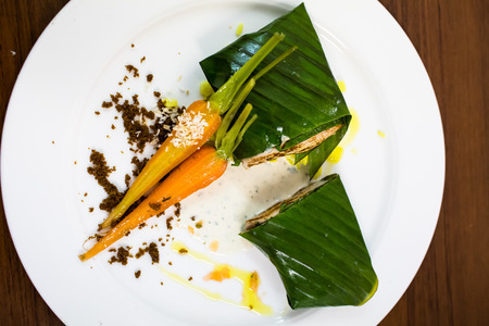 Fish baked in leaves with Vichy carrots. Fine dining, restaurant Stock Photo - 96988895