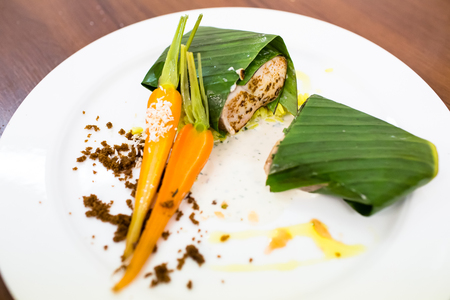 Fish baked in leaves with Vichy carrots. Fine dining, restaurant