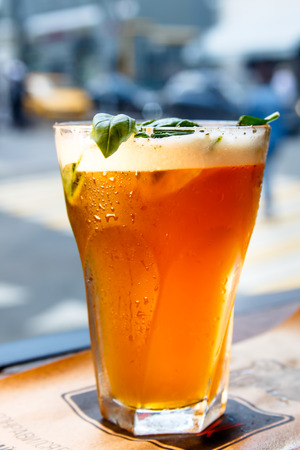 Iced tea in a misted glass is on the table. Stock Photo