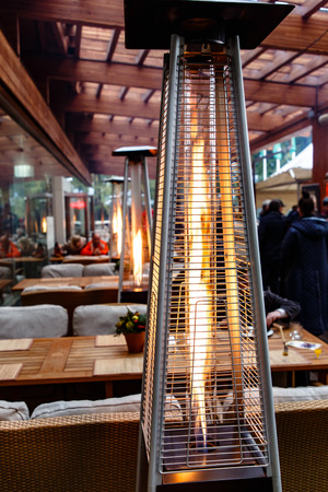 Gas heaters on the veranda of the restaurant, autumn, rain.