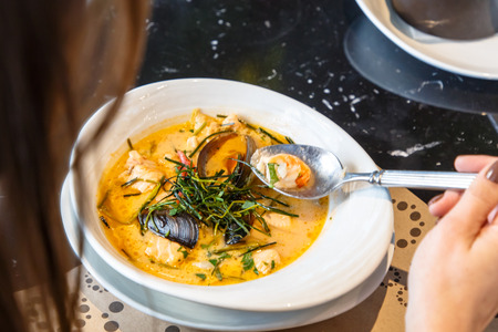 Cream soup with seafood, shrimp, mussels, langoustines, fish
