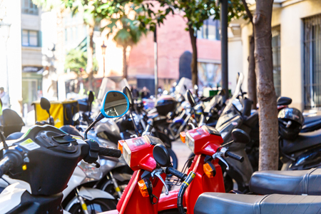 Parking of motor scooters and motorcycles in the center of the European city
