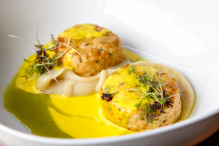 Chopped chicken or fish cutlets with mashed potatoes and yellow sauce