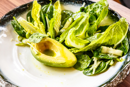 Green Salad with avocado and lettuce is on the plate
