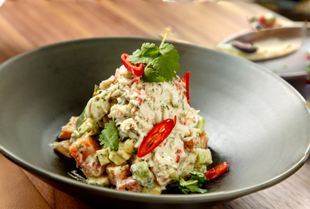 Green Salad with crabs and avocado is on a plate