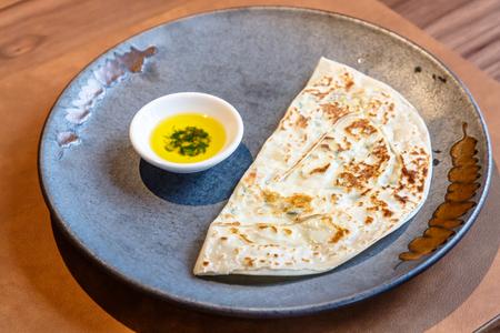 Kutab, a traditional Arabic dish, lies on a plate Banco de Imagens - 122028340