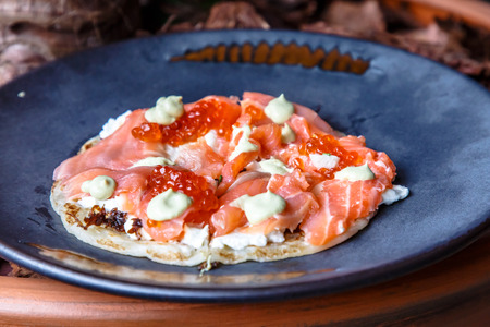 Roti Paratha stuffed with salted salmon and red caviar with cream.