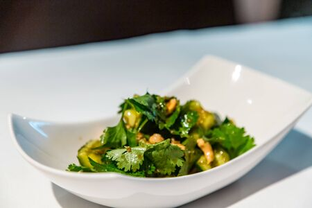 Chinese cuisine. Broken cucumbers with nuts.