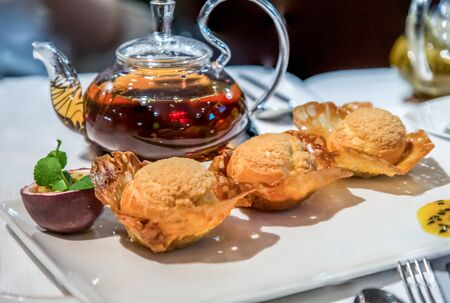 Chinese cuisine. Desserts with passion fruit and a pot of tea Banco de Imagens