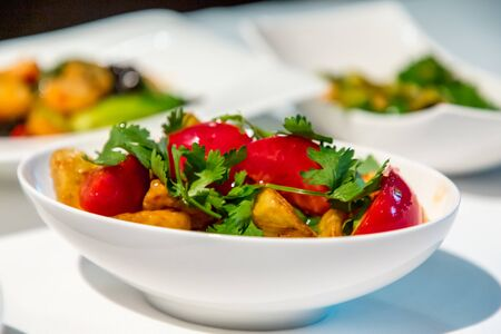 Chinese cuisine. fresh tomatoes and fried eggplant.