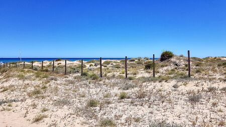 Rope fence in the dunes on the beach.