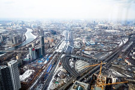 Aerial photography Moscow in early spring. Still some places snow.