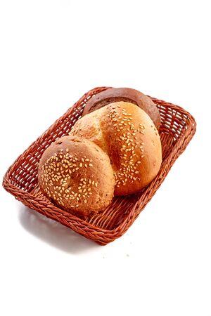Small round buns lie in the bread basket