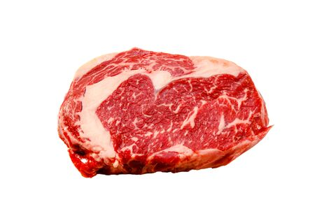 A rib eye steak of marbled grain-fed beef lies on a white background. Isolated. Reklamní fotografie