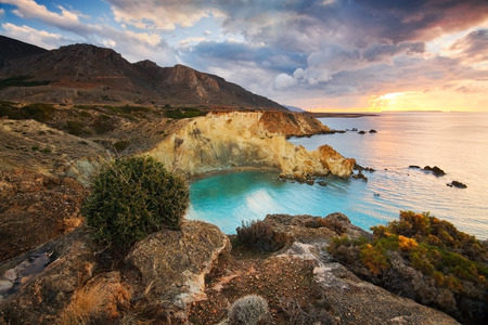 View of a typical coastline of south eastern Crete wit rugged mountains, cliffs, hidden beaches, coves and scrubby mediterranean vegetation, Greece  Stock Photo