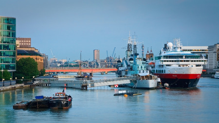 hms: HMS Belfast and a cruise ship on river Thames in London