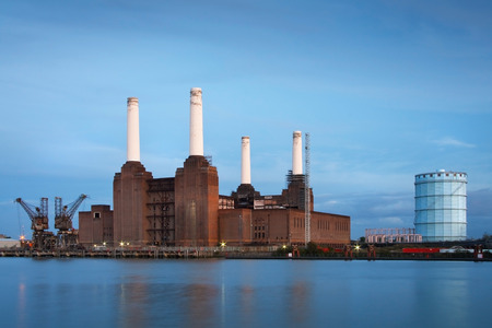 Battersea power plant reflecting on river Thames, London  photo