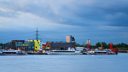 newham: Mix of industries and residential buildings on bank of Thames in Newham, London