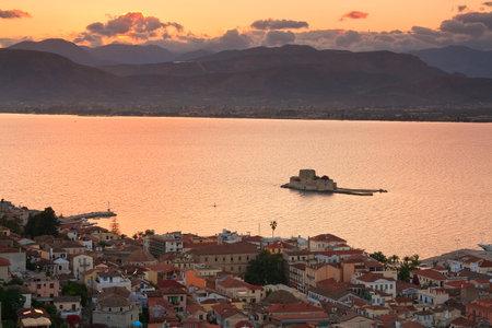 bourtzi: Evening scene with Bourtzi castle and Nafplio in Peloponnese, Greece. Editorial