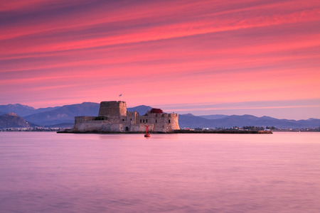 nafplio: Sunset over Bourtzi castle in Nafplio, Greece.