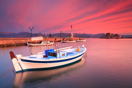 bourtzi: Fishing boats and Bourtzi castle in the Nafplio harbour in Peloponnese peninsula, Greece.