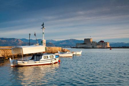 bourtzi: Fishing boats in Nafplio harbour and Bourtzi castle, Greece.