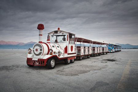 nafplio: Land train in Nafplio seafront, Greece. Editorial