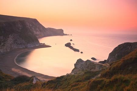 jurassic coast: Morning on the cliffs of Jurassic coast in Dorset, UK. Stock Photo