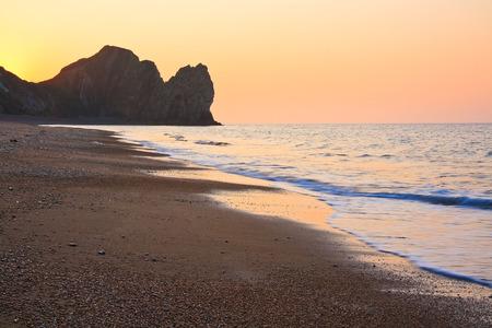 durdle door: Morning on the beach at Durdle Door in Dorset, UK.
