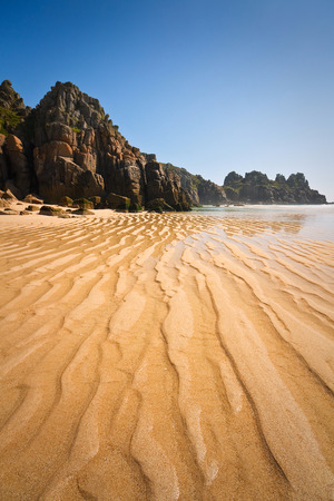 porthcurno: Porthcurno beach in low tide, Cornwall, UK. Stock Photo