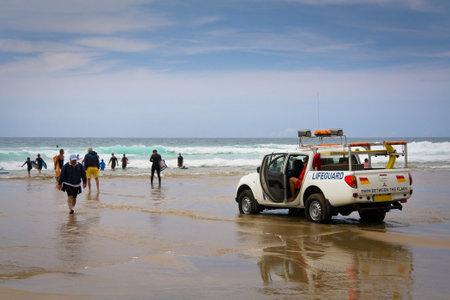 patrolling: Lifeguard patrolling a beach at Porthtowan in Cornwall, UK
