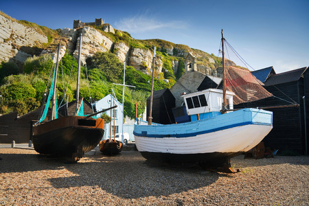 hastings: Boats among historic net huts in Hastings harbour, UK. Editorial