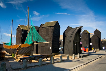 hastings: Historic net huts in Hastings harbour, UK.