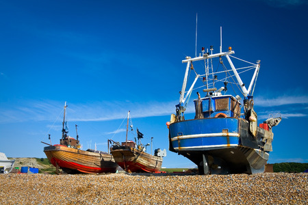 hastings: Boats on a beach in Hastings, UK.