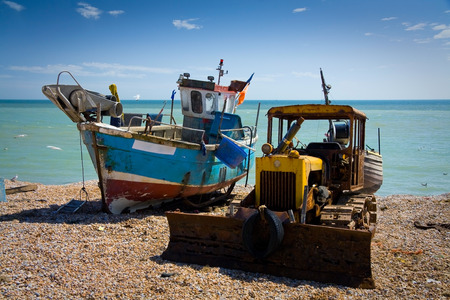 hastings: Fishing boat and a bulldozer, Hastings, East Sussex, UK.