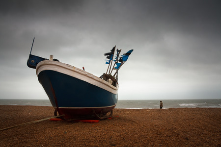 hastings: Fishing boat on a beach in Hastings harbour, East Sussex, UK.