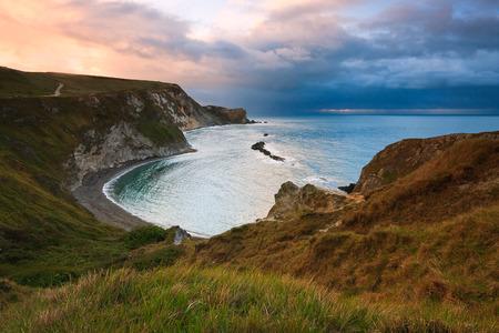 Beach on Jurassic coast in Dorset, UK. Фото со стока