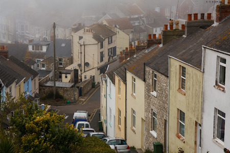 portland: Portland houses in fog, Dorset, UK.